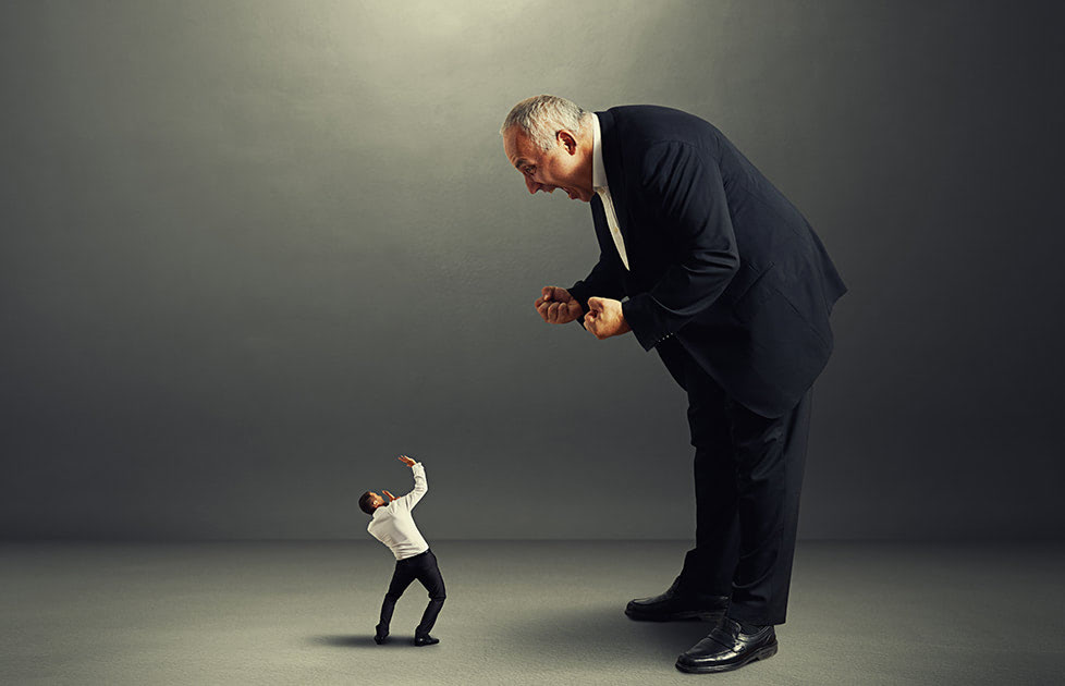 big angry boss screaming at small startled worker
